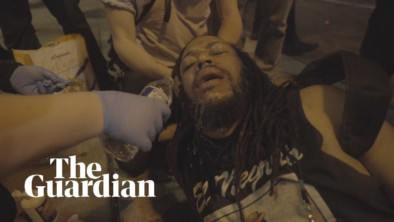 African American film-maker is pepper-sprayed then engages protest police in