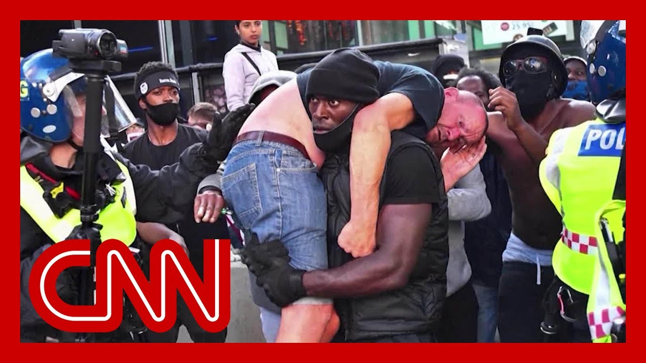 Black Lives Matter demonstrator carries injured white protester to safety