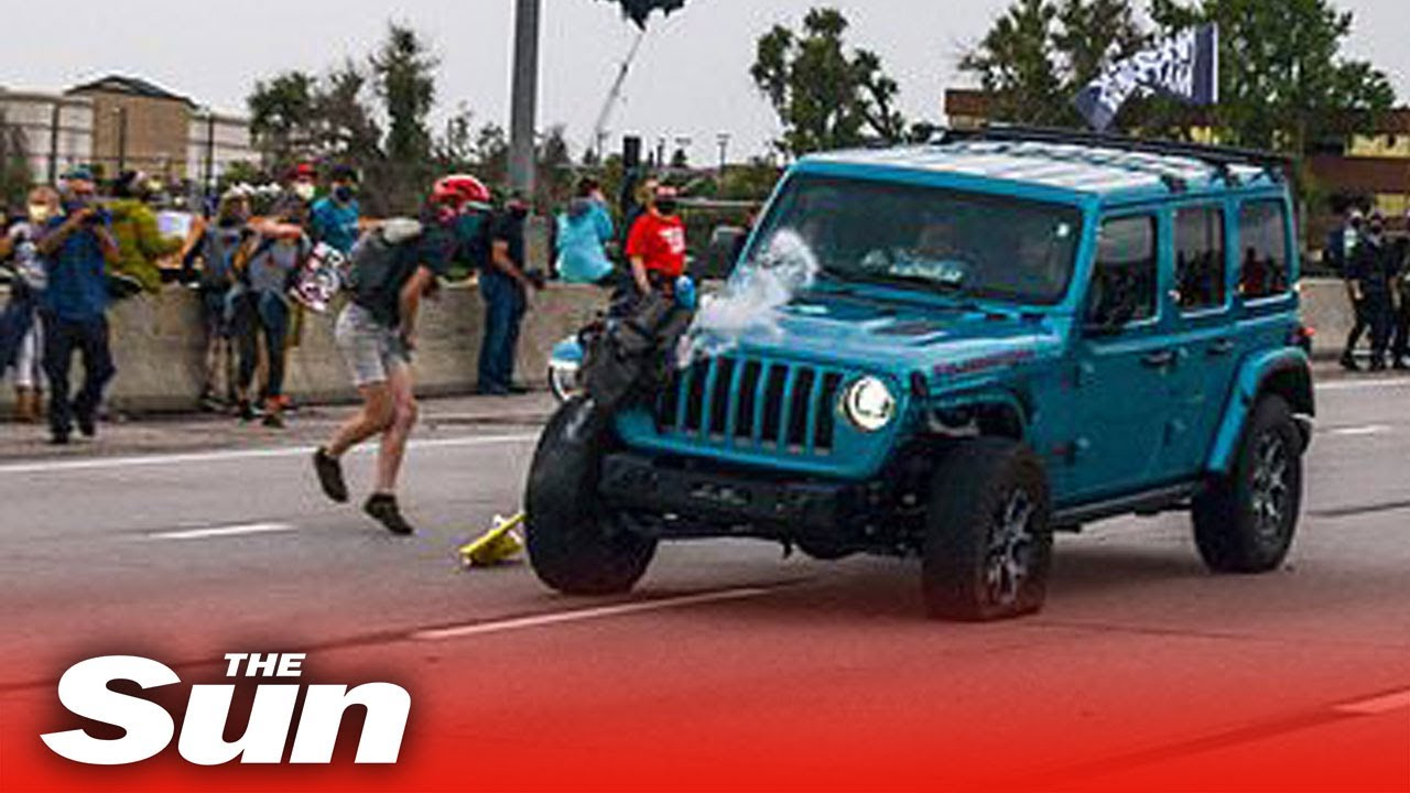 Jeep mows into Black Lives Matter march before protester fires