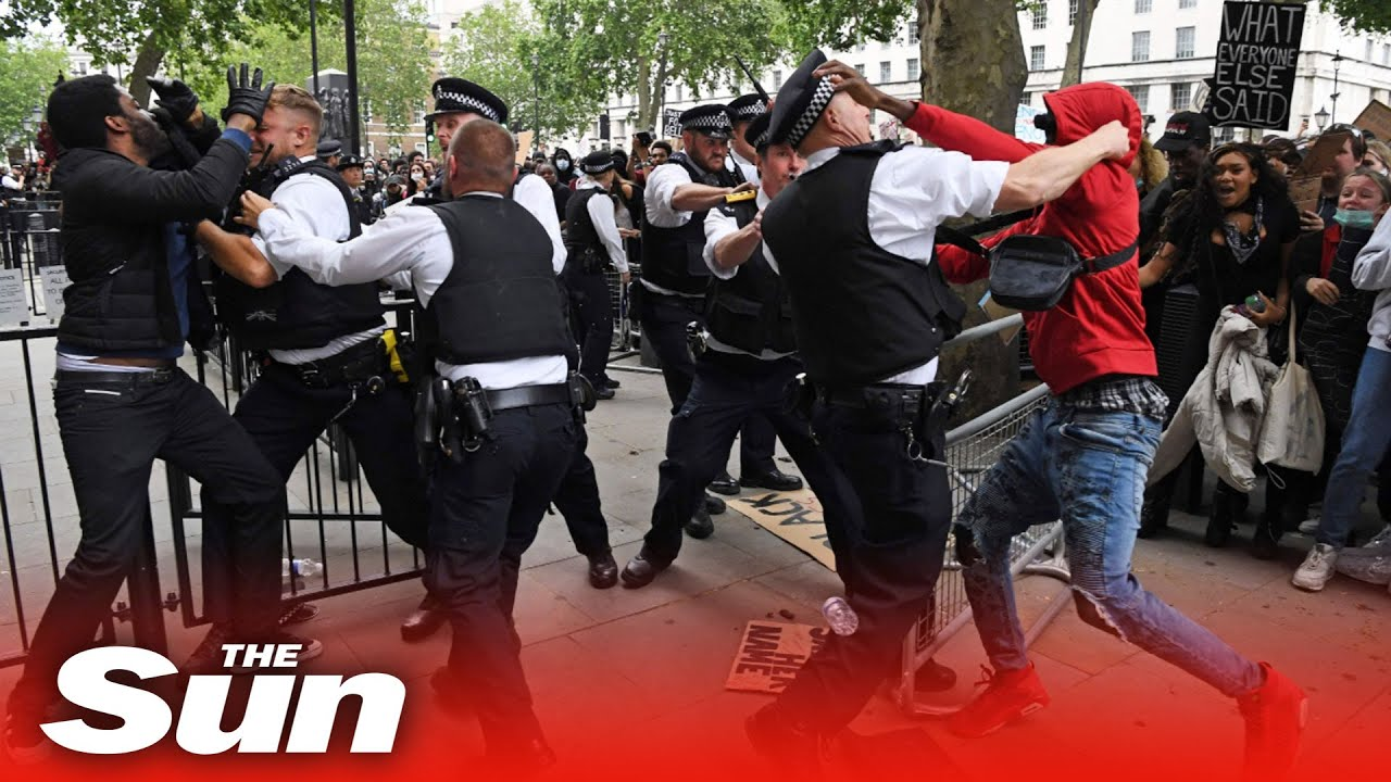 Police officer punched in scuffles outside Downing Street at Black