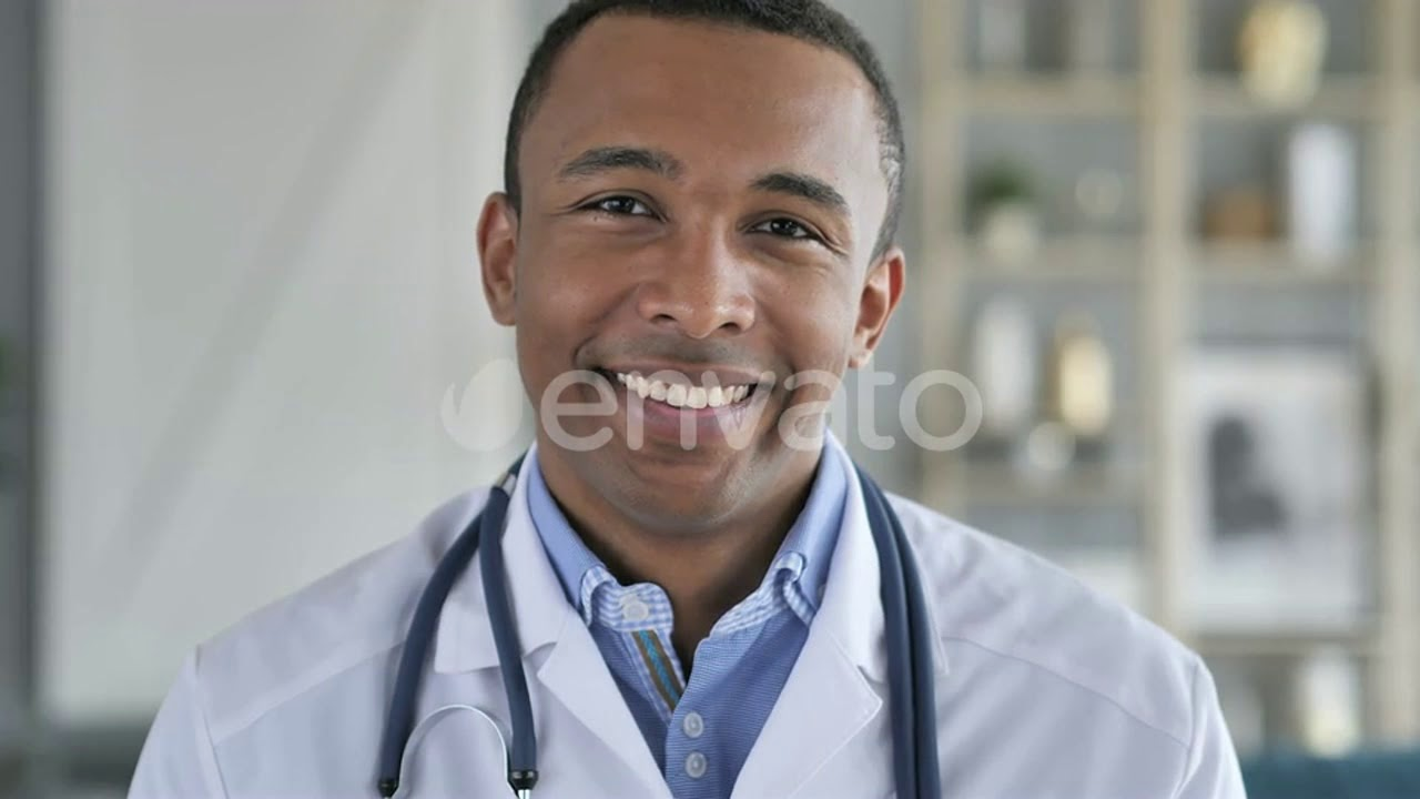 AfricanAmerican Doctor Reading medical Report, – (medical) Stock Footage |