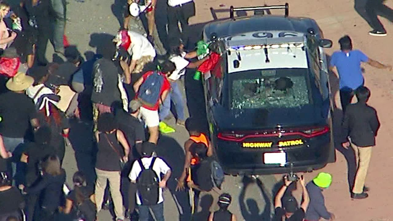 Black Lives Matter protesters smash window of CHP cruisers near