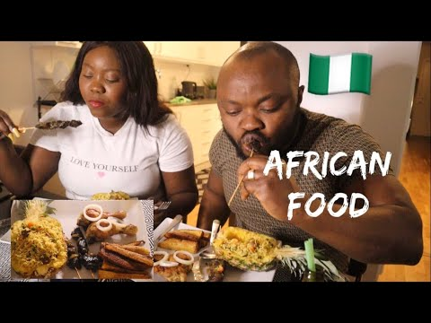 EATING NIGERIAN FRIED RICE WITH CHICKEN AND GRILLED BEEF |