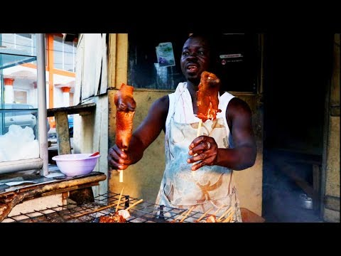 Eating Roasted Cow Testicles on the streets of OSU ,Ghana