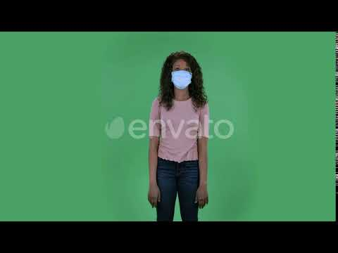 Portrait of Beautiful African American Young Woman in Medical Mask
