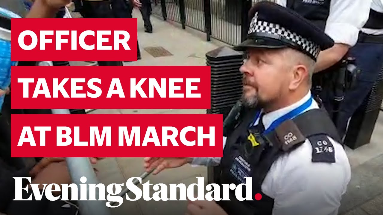 Police Officer takes a knee outside Downing Street at Black