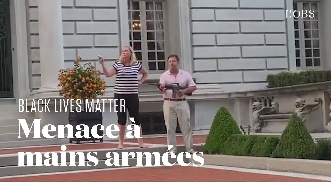 Un couple armé menace des manifestants Black Lives Matter à